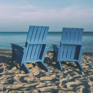 two empty beach chairs looking out to sea
