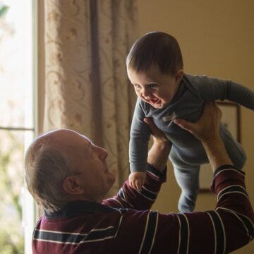 Grandfather lifting his grandchild up