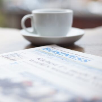 newspaper and a cup of coffee